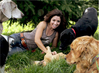 Dog Trots' Owner, Gloria Cropper, is an experienced dog trainer and a benevolent leader of her dog-walking pack.